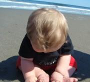baby on beach sand momspark.net