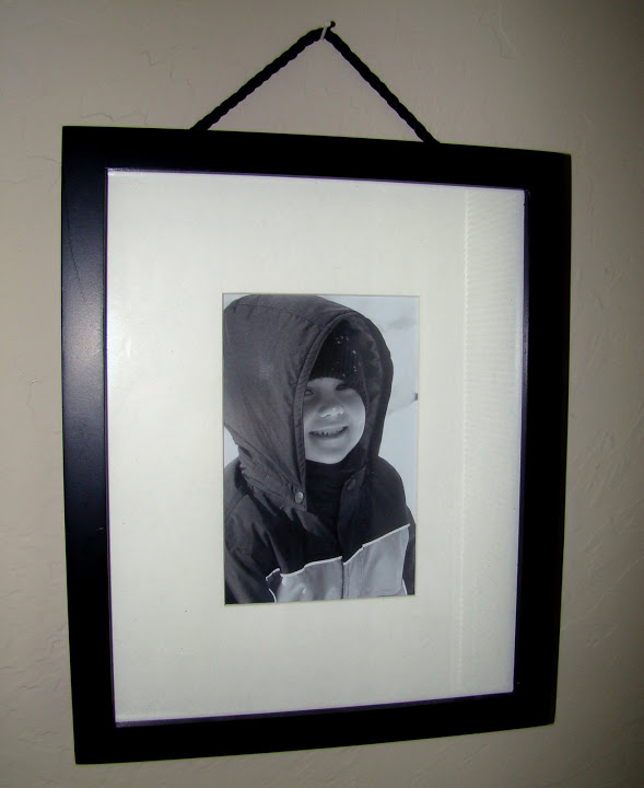 Use Pencil Erasers to Level Picture Frames