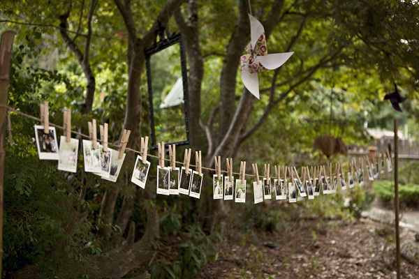 photos hanging out on clothesline
