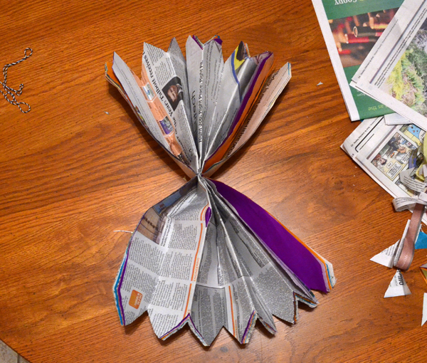 Reuse that newspaper to make some pretty and giant paper flowers!