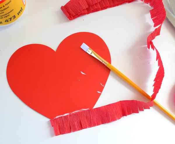 This fringe-y heart banner is super simple to make, super cute and won't break the bank because it's also super cheap!