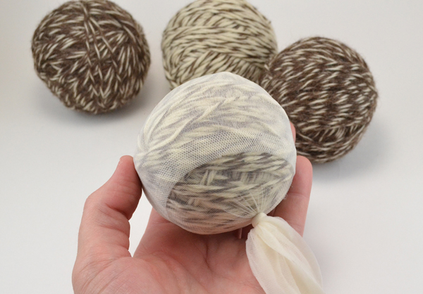 Go green! Felted wool dryer balls are super easy to make, save on energy bills and eliminate your need for fabric softeners chock full of chemicals!