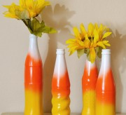 A little spray paint and a few pop bottles and you've got some super cute fall decor!