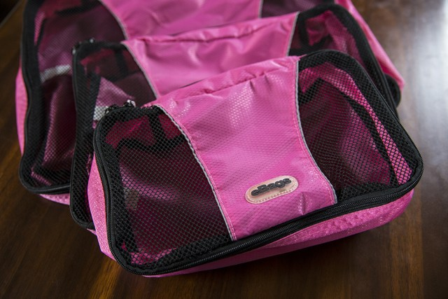 Genius Hacks for Packing Your Carry-On Suitcase - Use packing cubes.  I started using packing cubes a few years ago and never looked back. These awesome cubes are basically rectangle bags with zippers that you can place folded clothes into and then zip up.