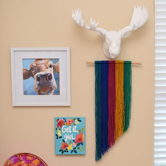 Add some color to your walls by raiding your yarn stash! This jewel tone yarn hanging is simple and very pretty!