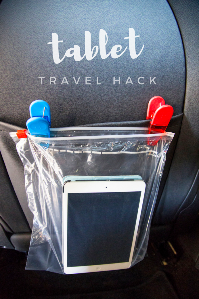 If you have two or more kids in tow and only one tablet to share among them, it's inevitable that there will be a scuffle over whose turn it is to use the device. Luckily there's an easy, peace-making hack for that. Simply place a tablet in a gallon-size storage bag and clip to the back of the headrest in the car This creates a makeshift display so everyone can see the movie without all of the fuss.