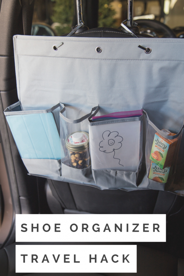 The last thing you want to worry about while traveling is trying to locate snacks or toys. Repurposing an over-the-door shoe organizer is the most genius solution. I recommend finding an organizer that has deep pockets, trimming it down to only the top row, attaching to the headrest with the provided hooks and stuffing those pockets with all the essential goodies you'll need to keep the kids entertained on your trip.