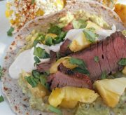 Carne Asada Taco Recipe for Cinco de Mayo! While this Cinco de Mayo recipe may seem long and fussy, it is very simple to put together. To save time you can prepare a few components ahead of time. The combination of spicy peppers, grilled pineapple, and Carne Asada is downright delicious.
