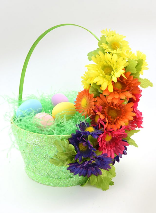 Easily embellish cheap Easter baskets with glitter, flowers and ribbons. So cute and inexpensive!