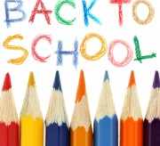 Crayons and back to school text over white background