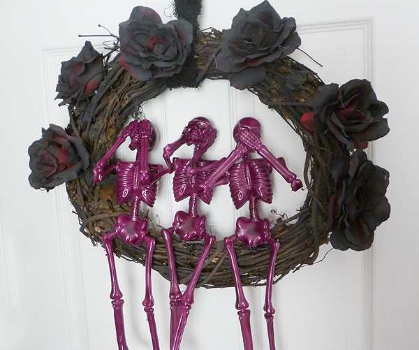 Spooky Halloween Skeleton Wreath  Halloween is the time of year for skeletons and spooky decor and I absolutely love it. I also absolutely love the see no evil, hear no evil, speak no evil statues and I decided to pair the two concepts together as one. The final product is dark, a little spooky and a lot cute.