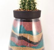 Not only is this cactus planter totally on trend, it's also a beautiful keepsake filled with sand from special places!