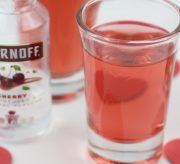 Pink cherry vodka shooters that are perfect for Valentine's Day night.