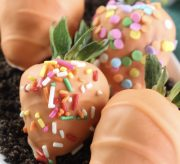 Spring Chocolate-Dipped Carrot Strawberries Recipe - This time of year makes me excited for all things bright and cheery, including the recipes I create. So, today's recipe is just that - springy, fun and DELICIOUS. Spring chocolate-dipped carrot strawberries! A fun recipe to make with the kids and oh-so-yummy for the whole family.