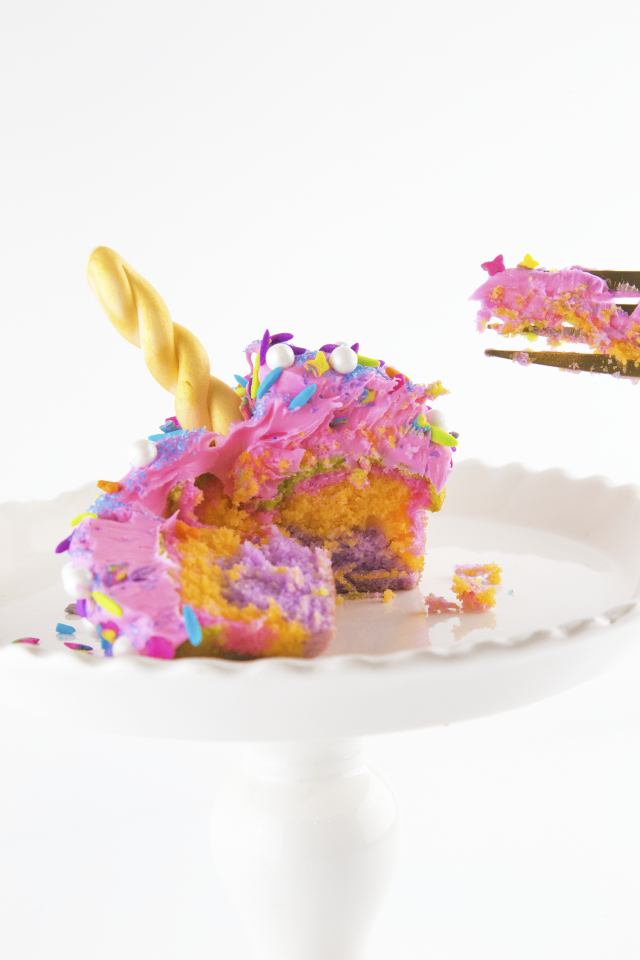 My unicorn obsession is real, my friends. Colorful, sweet, and bright rainbow colors of unicorn EVERYTHING. Unicorn ice cream, magic wands, and even poop. I'm into it all. These multi-colored cupcakes covered with a TON of sprinkles and a shiny gold horn are simply magical.